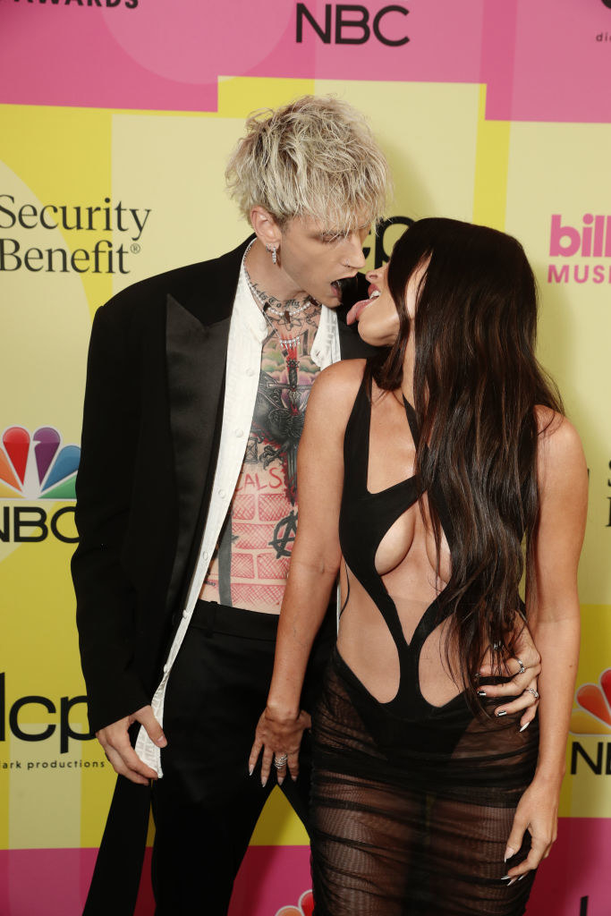 she wore a bodysuit with cutouts, and he wore a suit without a shirt