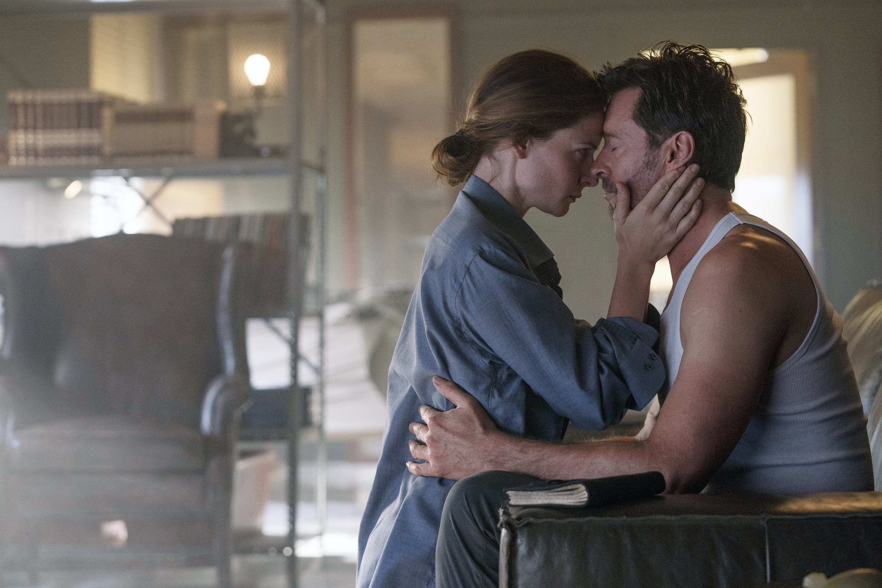 from left is Rebecca Ferguson and Hugh Jackman holding each other, 2021