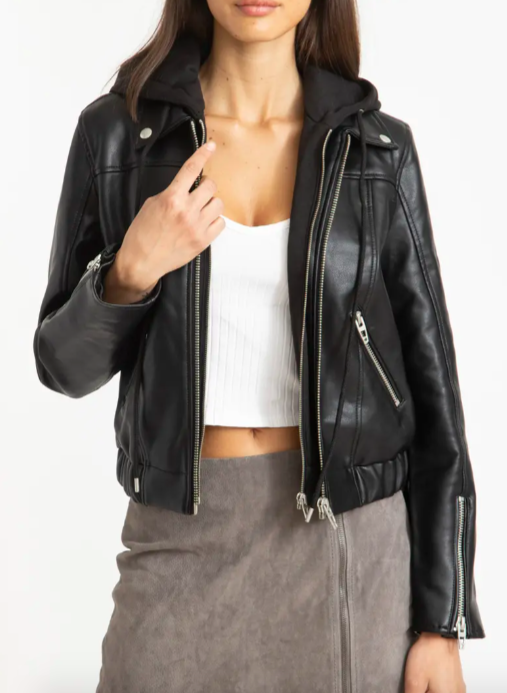 A model wearing the hoodie leather jacket