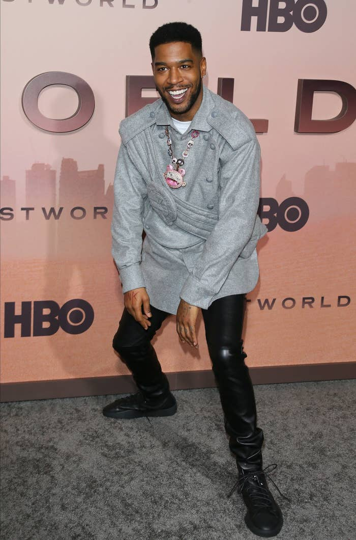 Kid Cudi smiling at a red carpet event