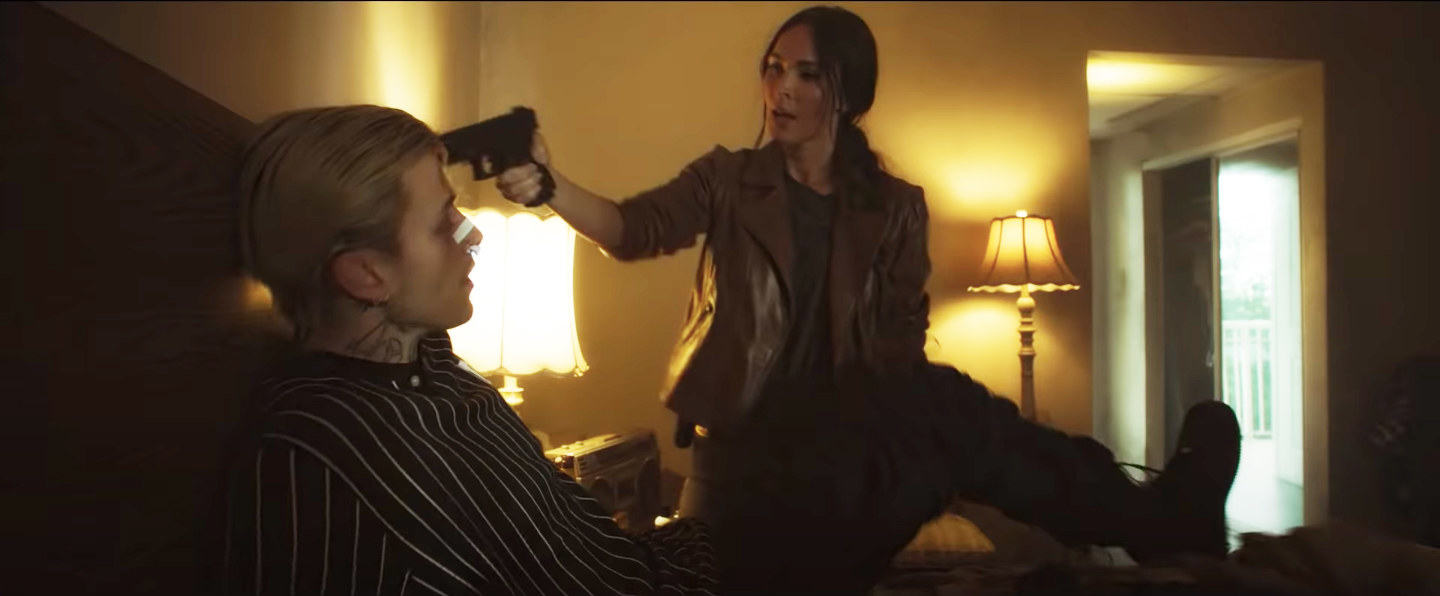 in a scene from the film, Megan threatens Colson with a gun