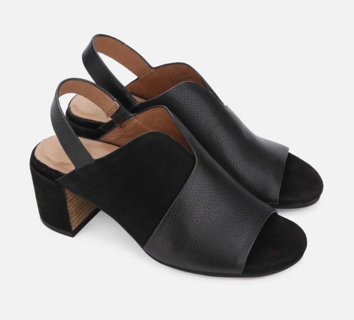 A pair of black leather/suede, slingback, block heel sandals