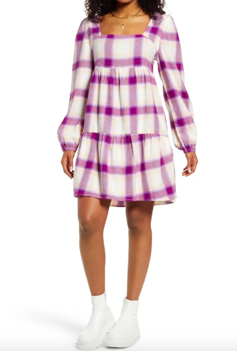 A model wearing the dress in ivory and purple