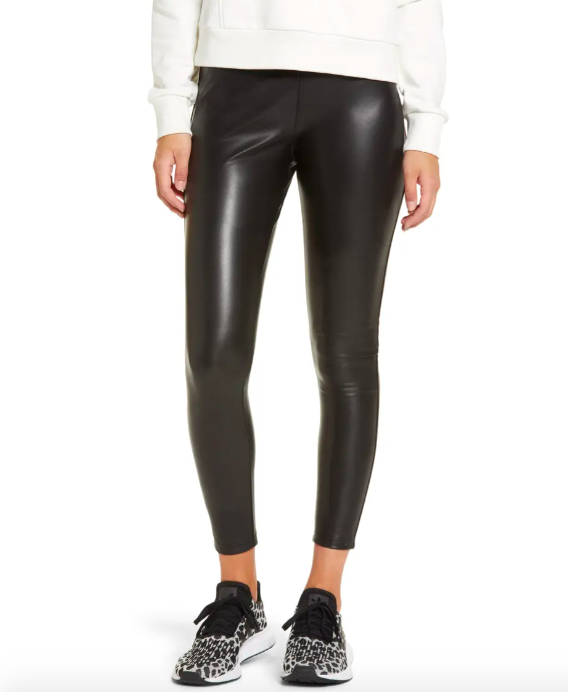 A model wearing the faux leather leggings with sneakers