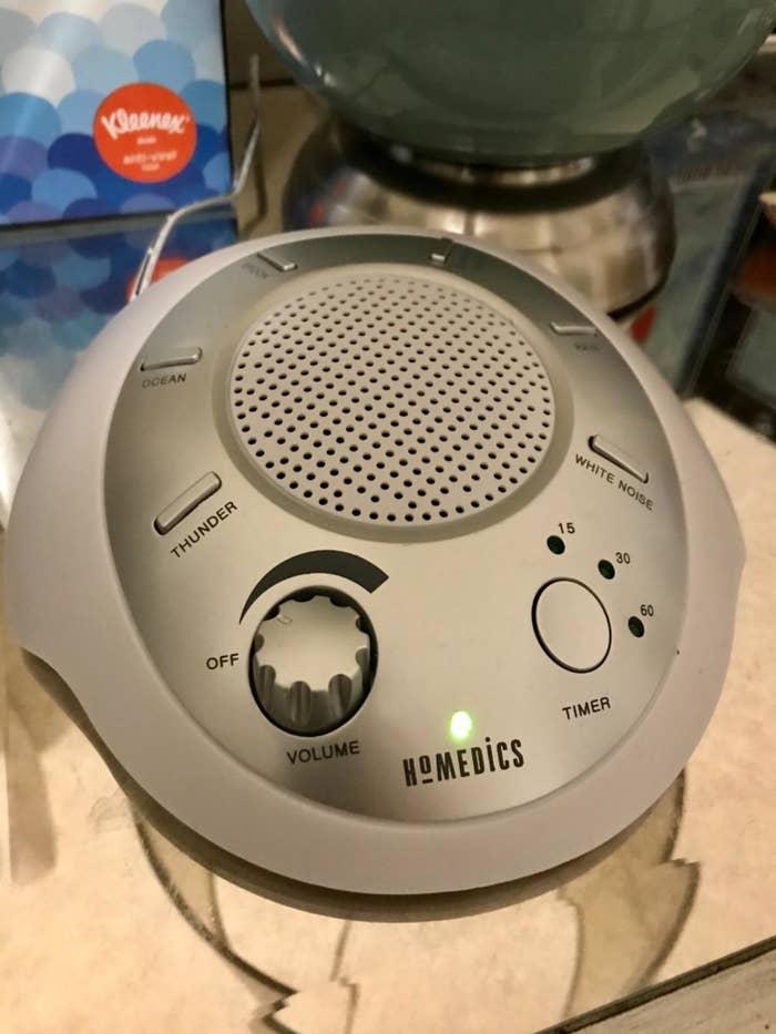 reviewer's homedics sound machine on a counter