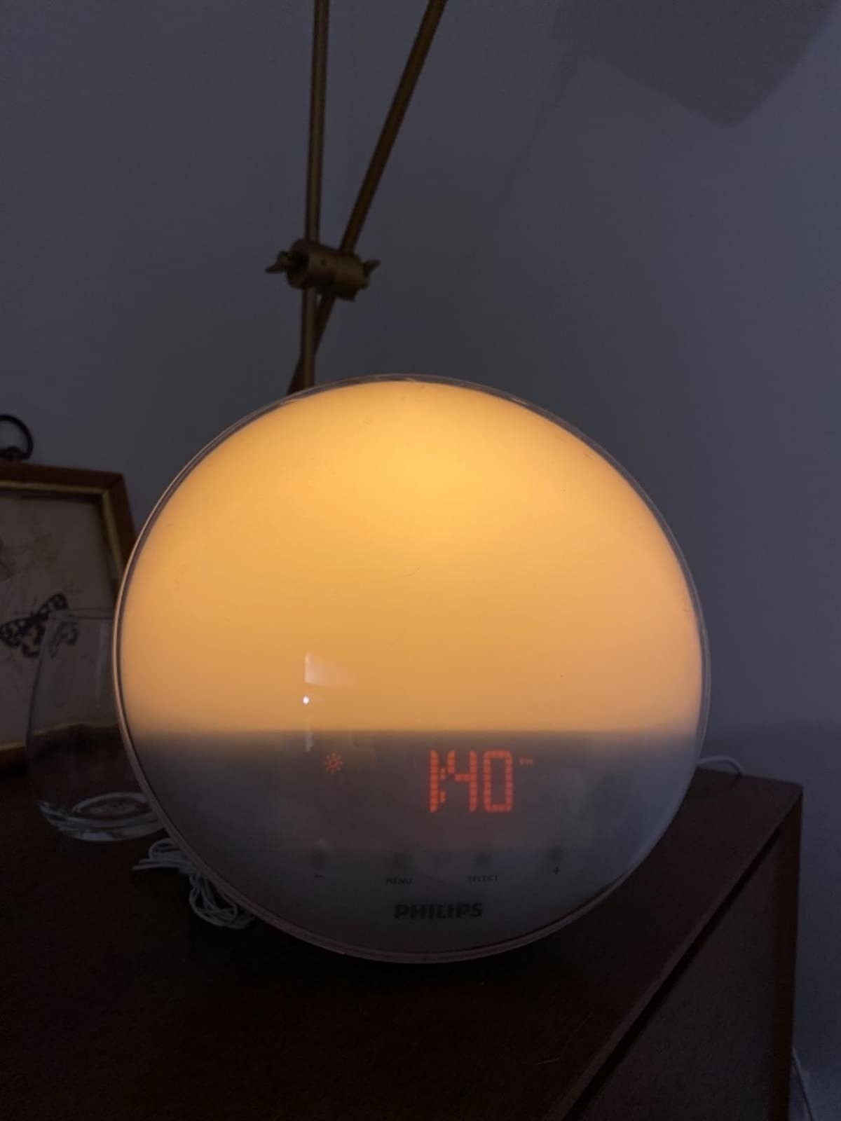 reviewer image of the phillips wake up light on a nightstand