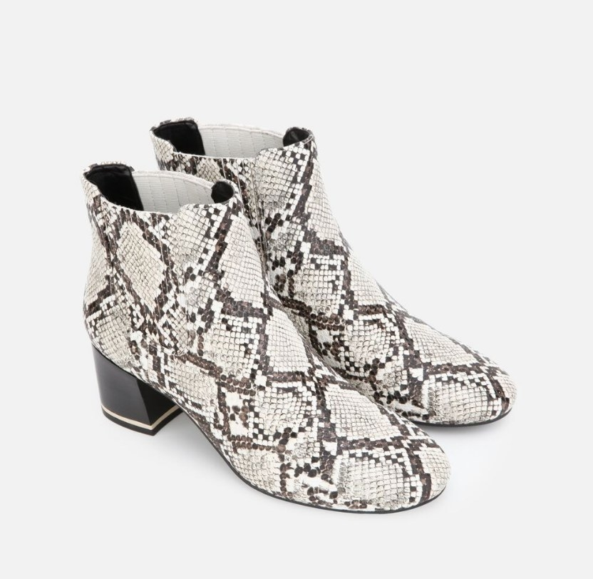 A pair of black/white leather snakeskin, block heeled ankle booties