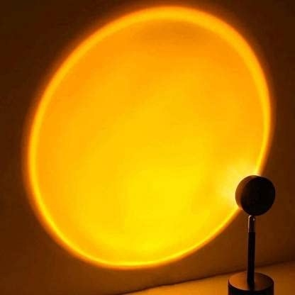 A lamp projecting a circle of light that looks like the sun on to a wall