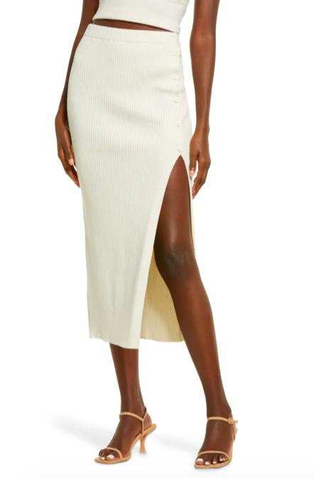 A model wearing the skirt in Ivory Bone