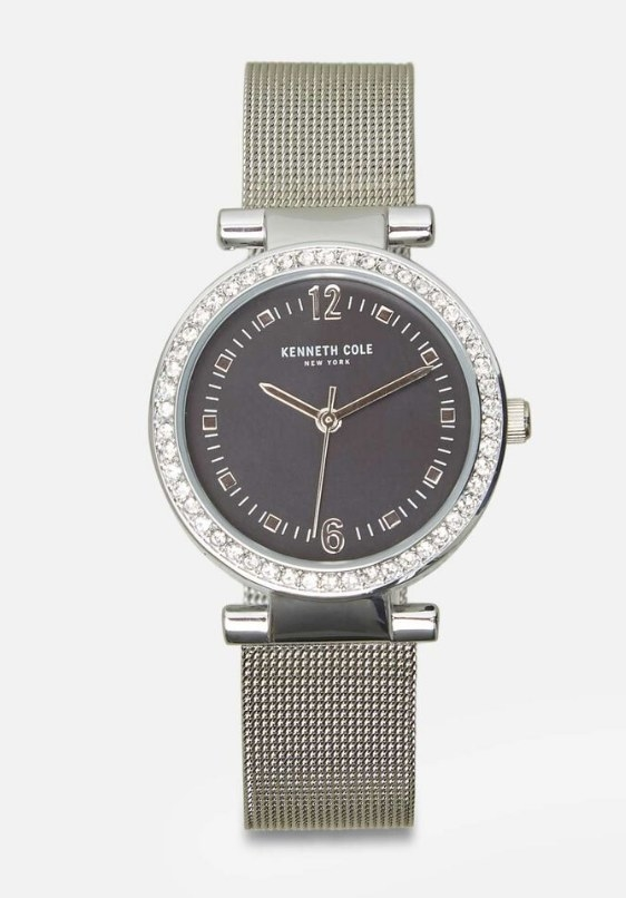 A silver/grey, mesh bracelet dial watch with crystals surrounding the face