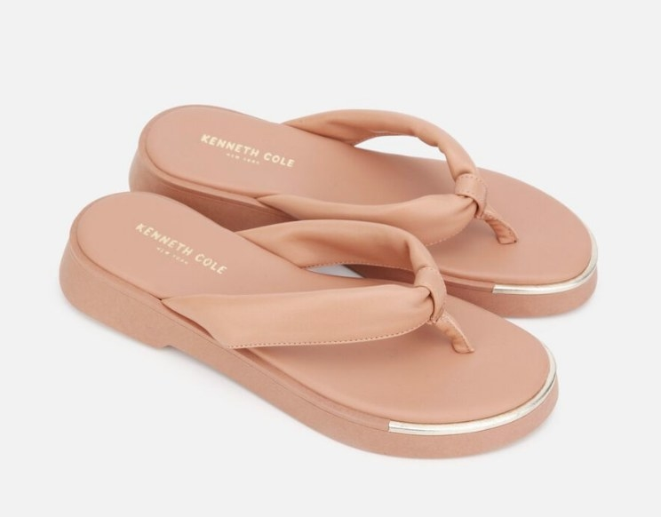 A pair of leather flatform thong sandals in peach