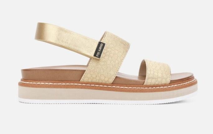 A gold, metallic slingback flatform sandal