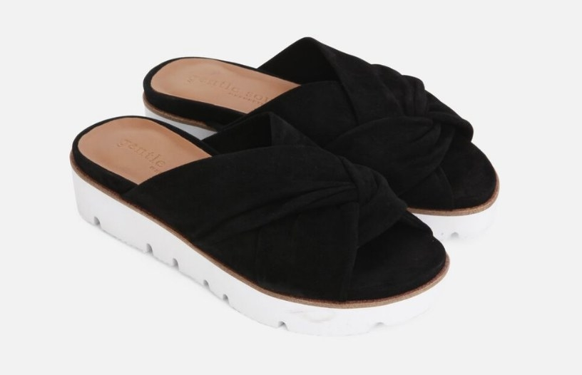 A pair of platform slides with a black braided strap and white sole