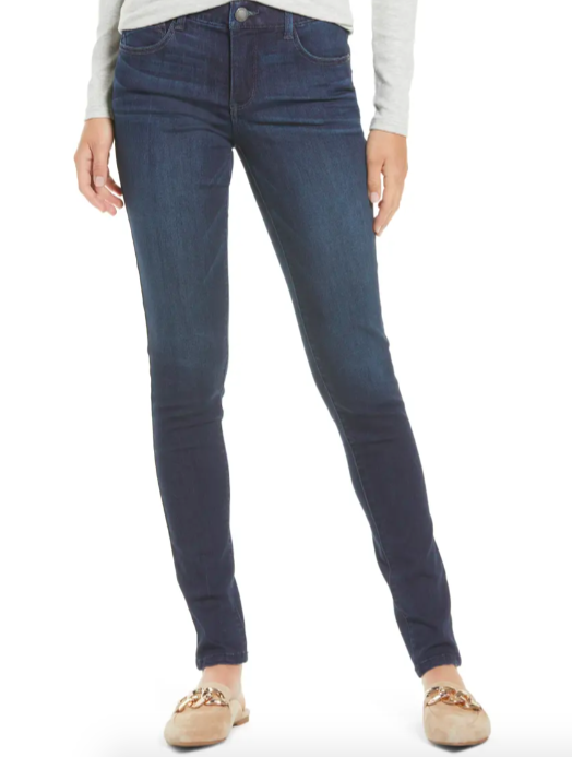 A model wearing theAb-Solution Skinny Jeans