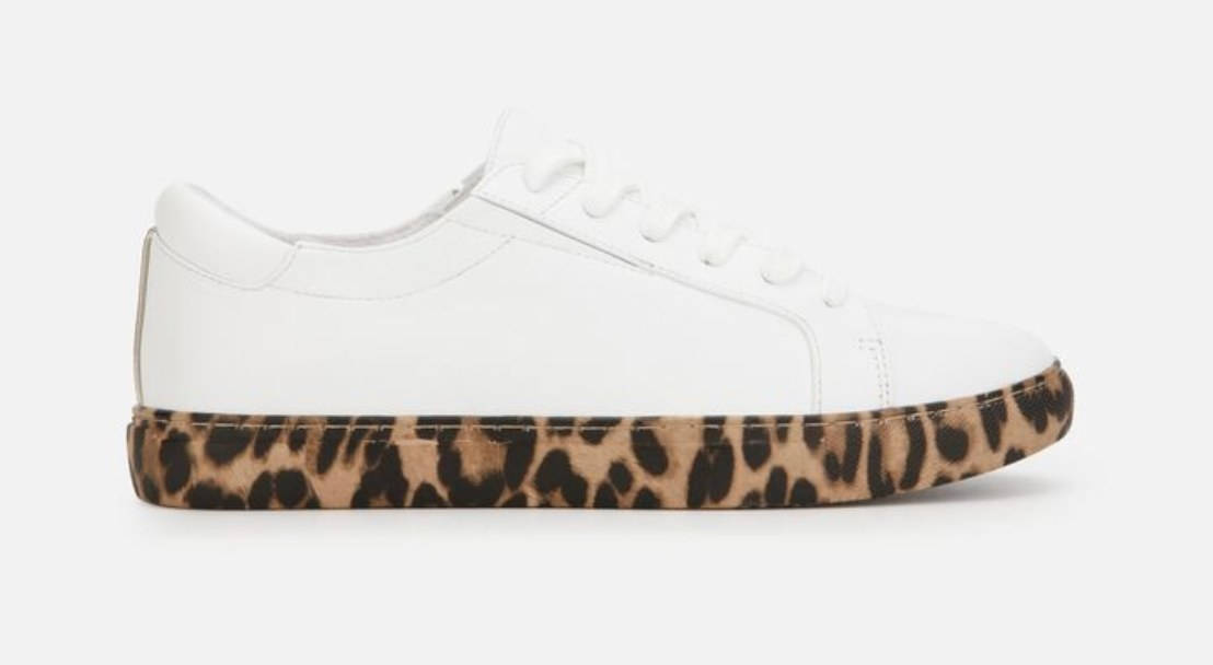 A white leather sneaker with a leopard sole accent