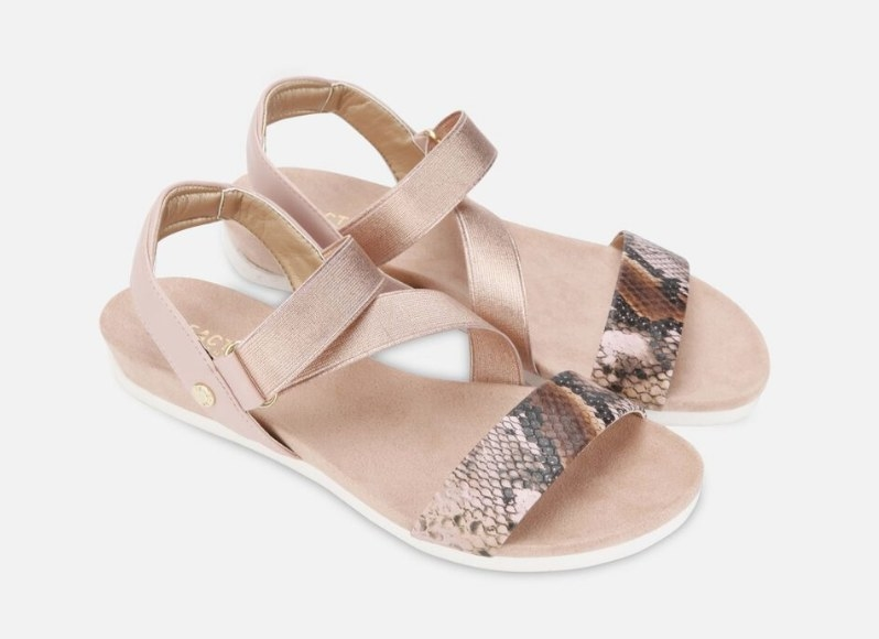 A quarts/rose gold, strappy sandal with a snakeskin front strap
