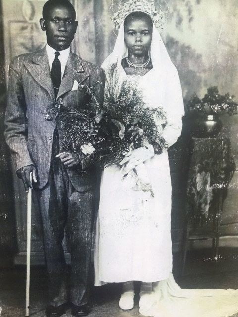 A wedding portrait of a man on the left and a woman on the right, both staring into the camera.