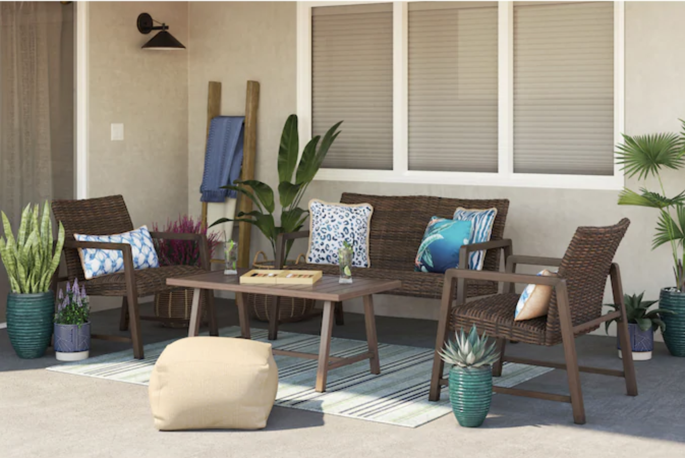 the four-piece patio set with patterned blue cushions