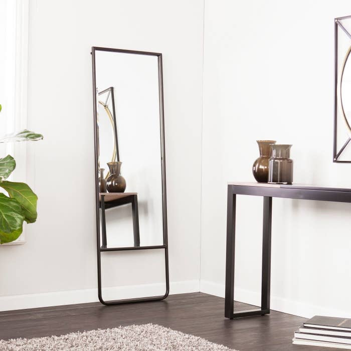 ¾ length leaning mirror with beveled edge and black frame
