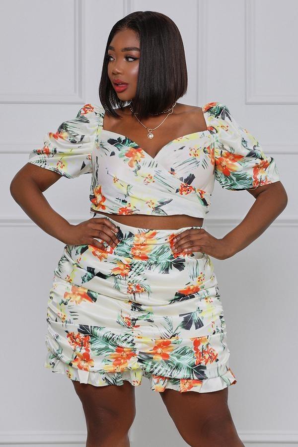 model in tropical-print ruffle crop top and mini skirt set