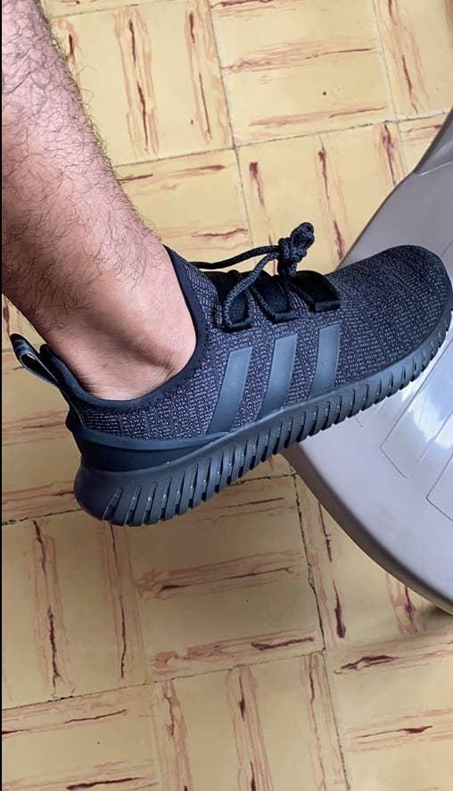 Reviewer photo of black adidas Kaptur sneaker