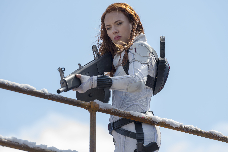 Black Widow holding a gun, ready to shoot
