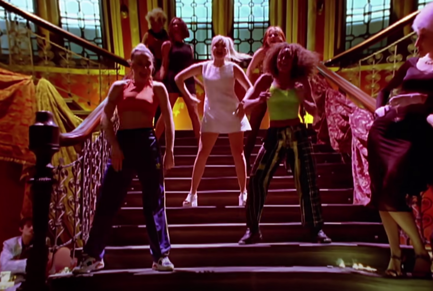 Screenshot of the Spice Girls dancing on a staircase