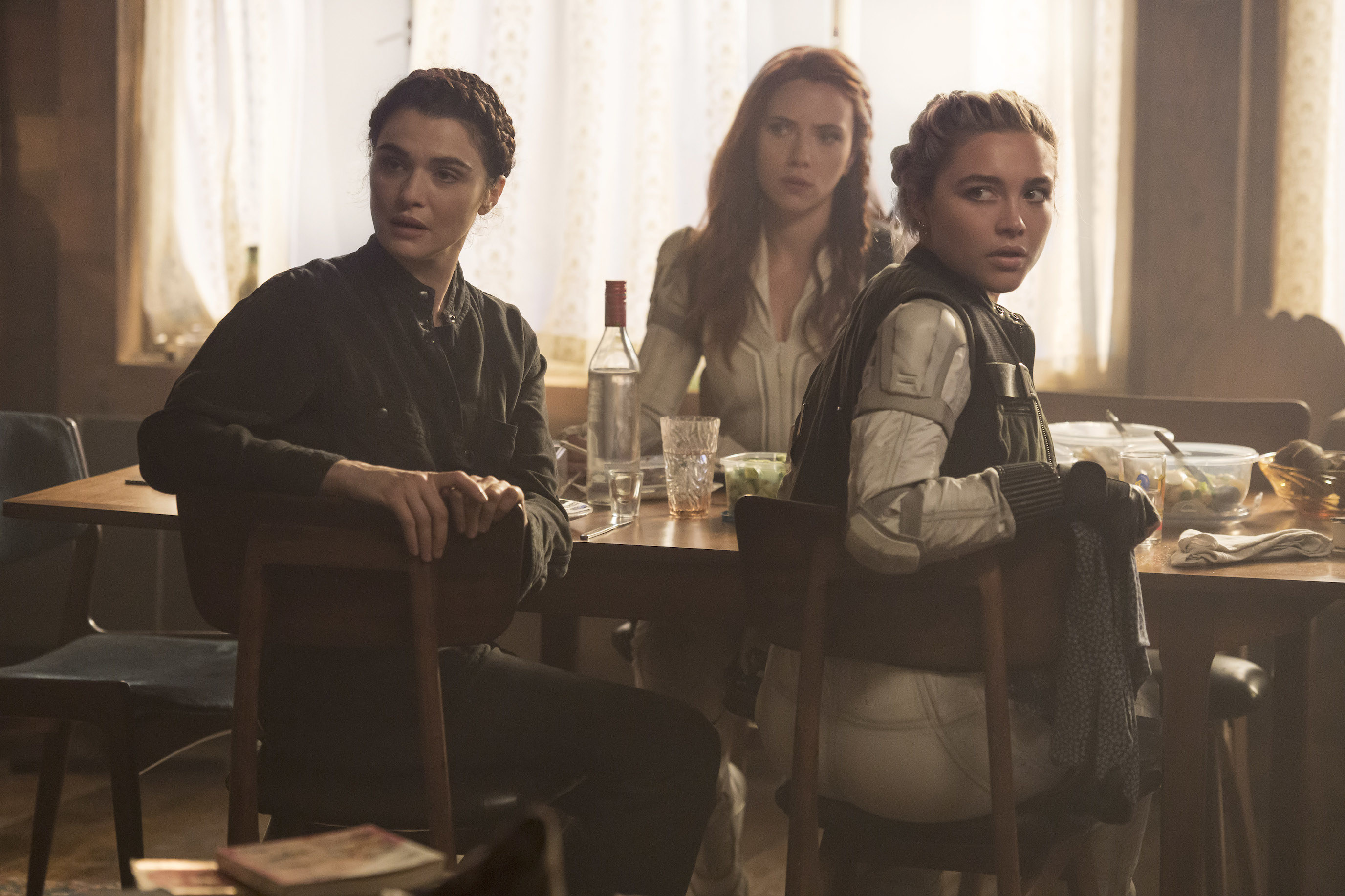 Rachel, Scarlett, and Florence sitting at a table