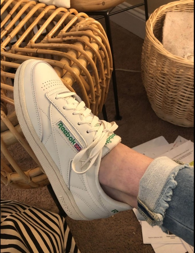 Reviewer image of white Reebok sneaker on foot