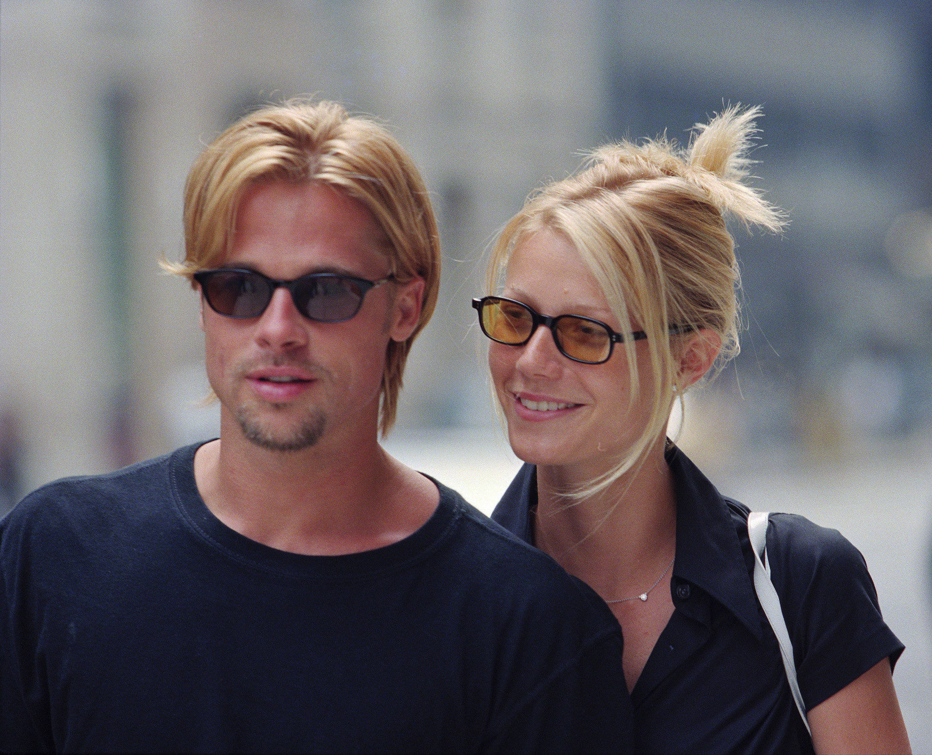 Brad and Gwyneth both dressed in black and walking down the street of NYC