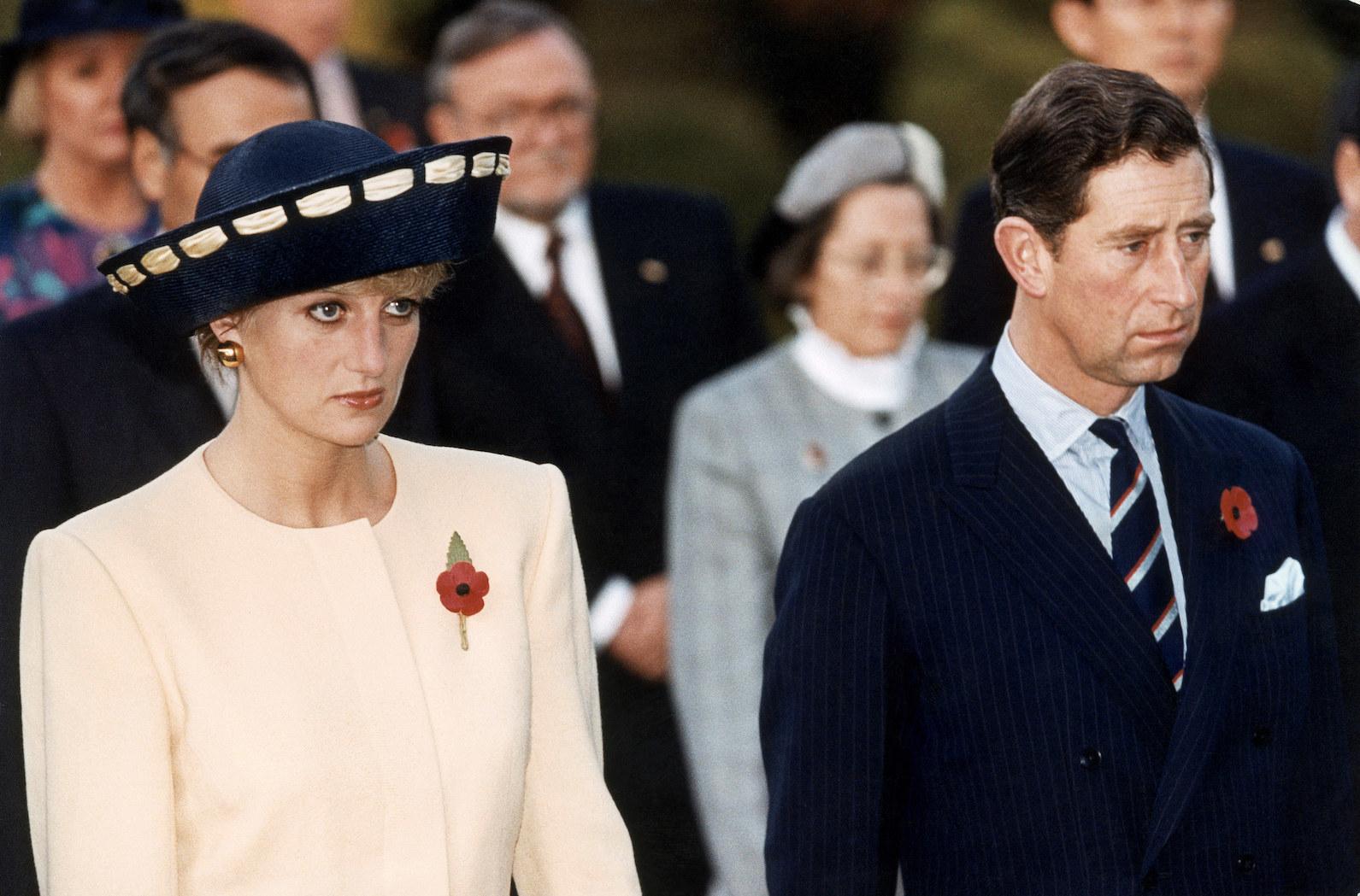 Princess Di and Prince Charles looking upset in 1992