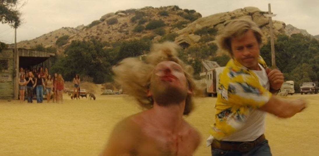 Cliff punches Clem in from of the Manson Family