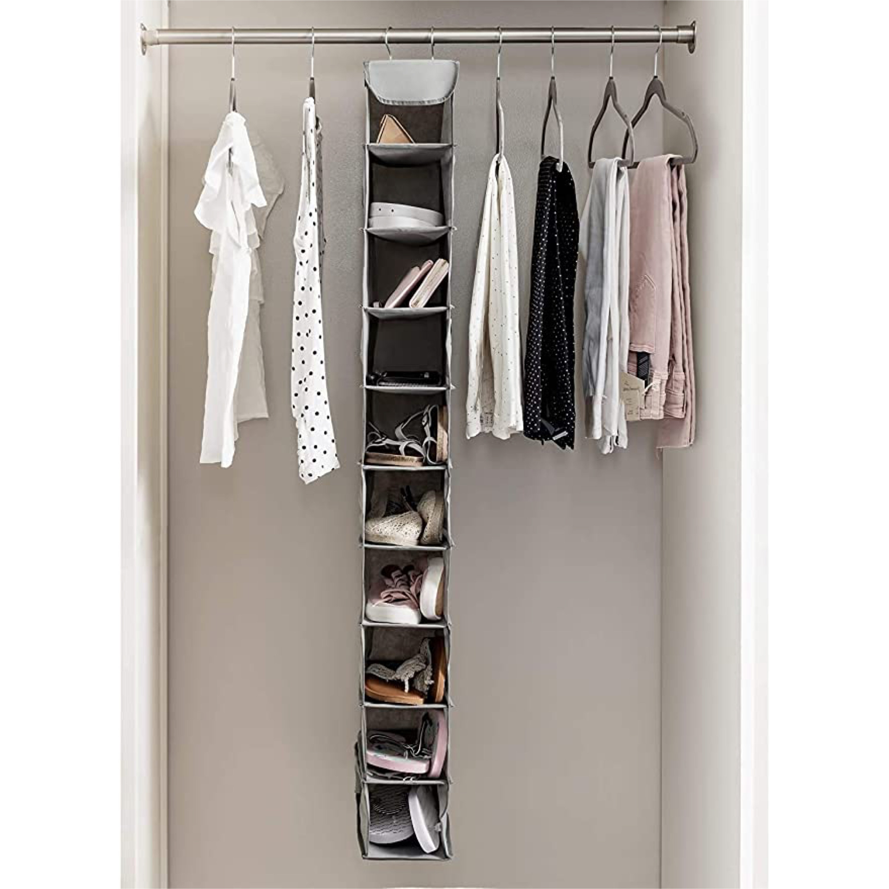 A vertical shoe organiser with multiple slots and hangers for easy storage