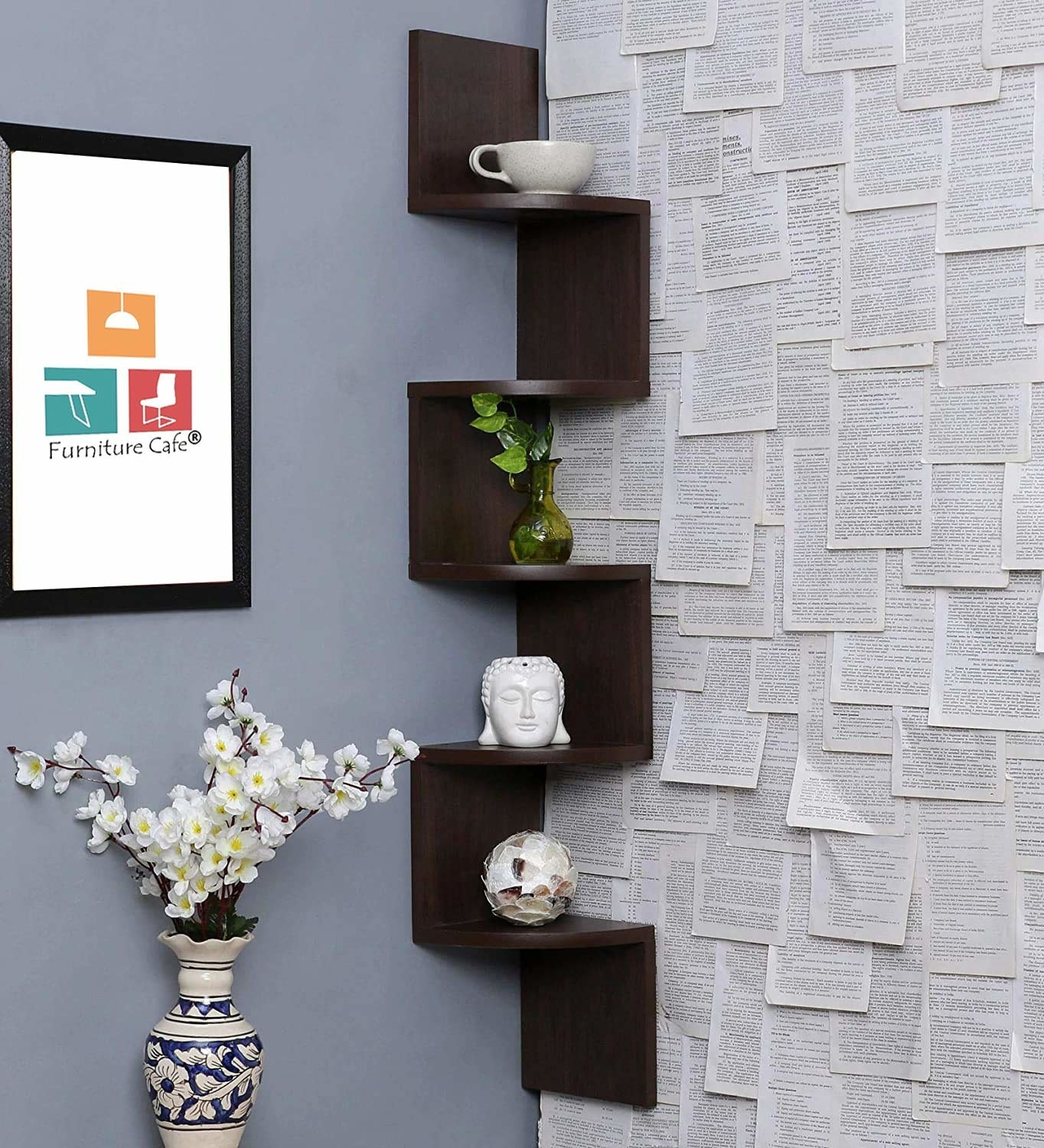 Zig wall shelves in the corner of a room, holding vases and other showpieces