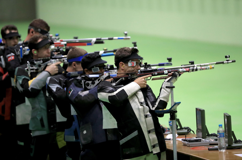 Row of men shooting at targets