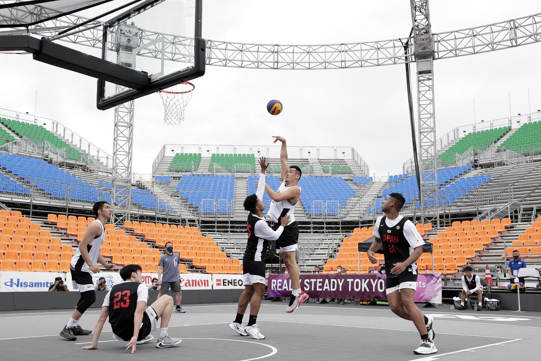 Men practicing basketball