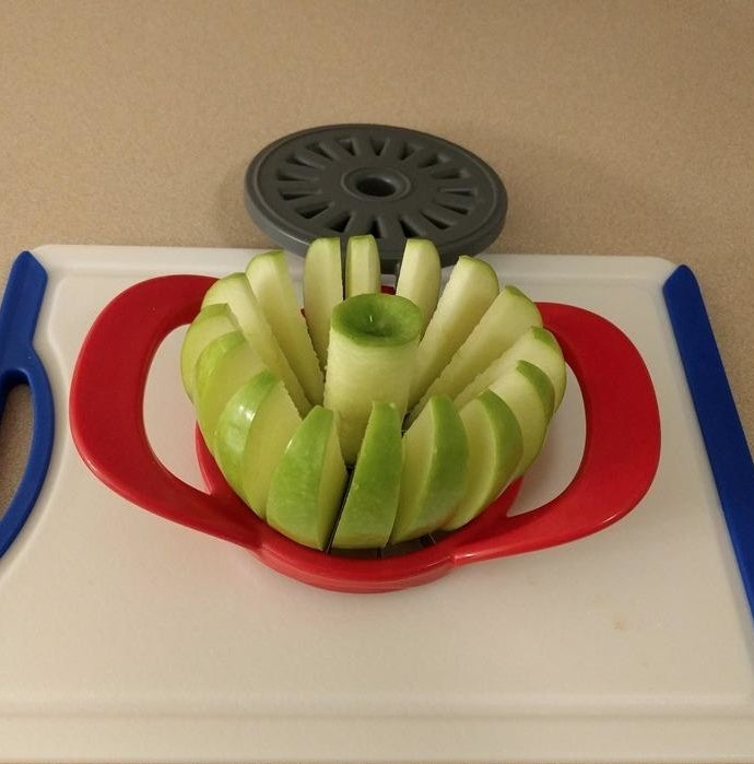 Reviewer photo of a Granny Smith apple sliced by the apple divider
