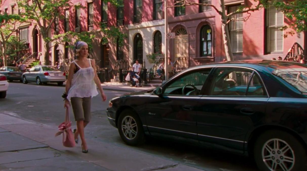 Carrie Bradshaw walking down the street