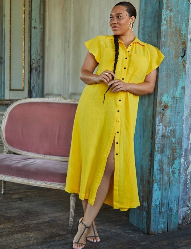 model in bright yellow ruffle sleeve shirt-style maxi dress with strappy sandals