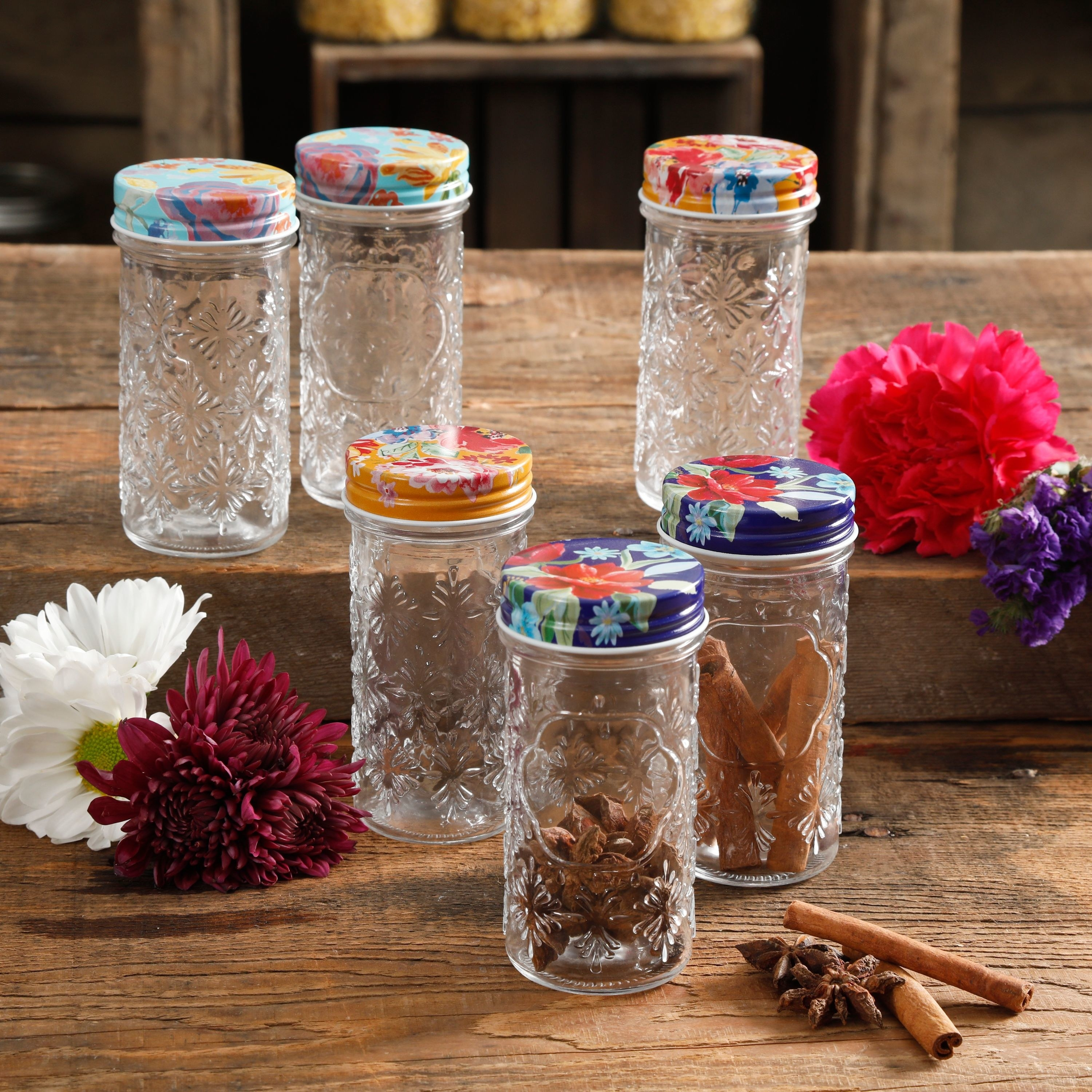 the spice jars, which have embossed glass bodies and colorful tin screw-on tops