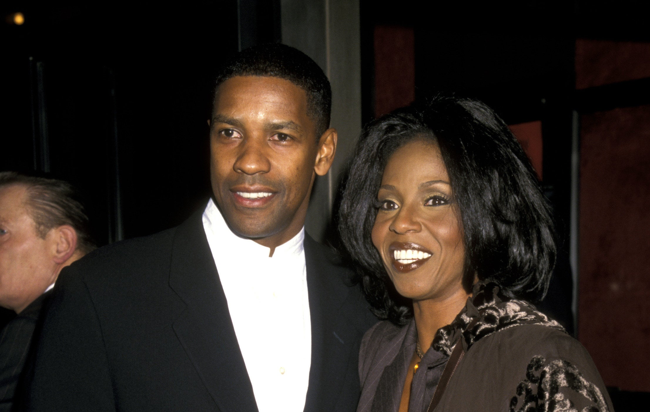 Denzel with his wife at a movie premiere