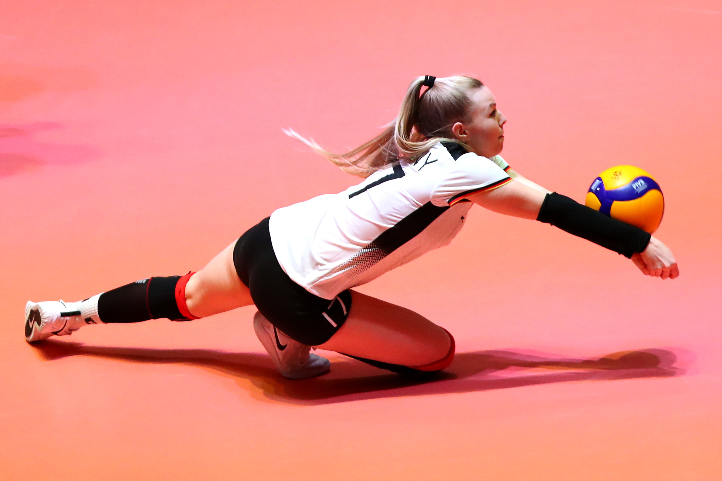 Volleyball player making a diving save