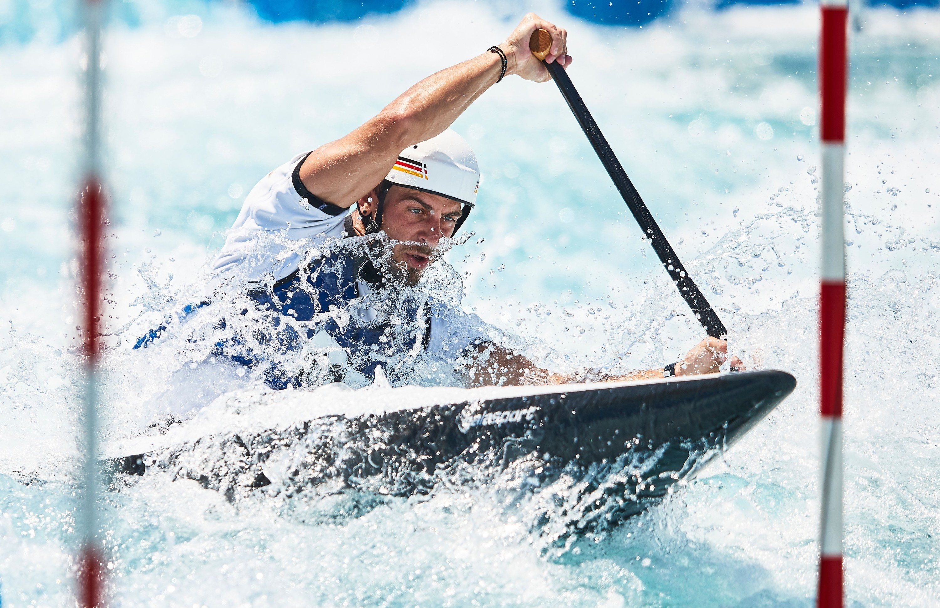 Man canoeing in white waters