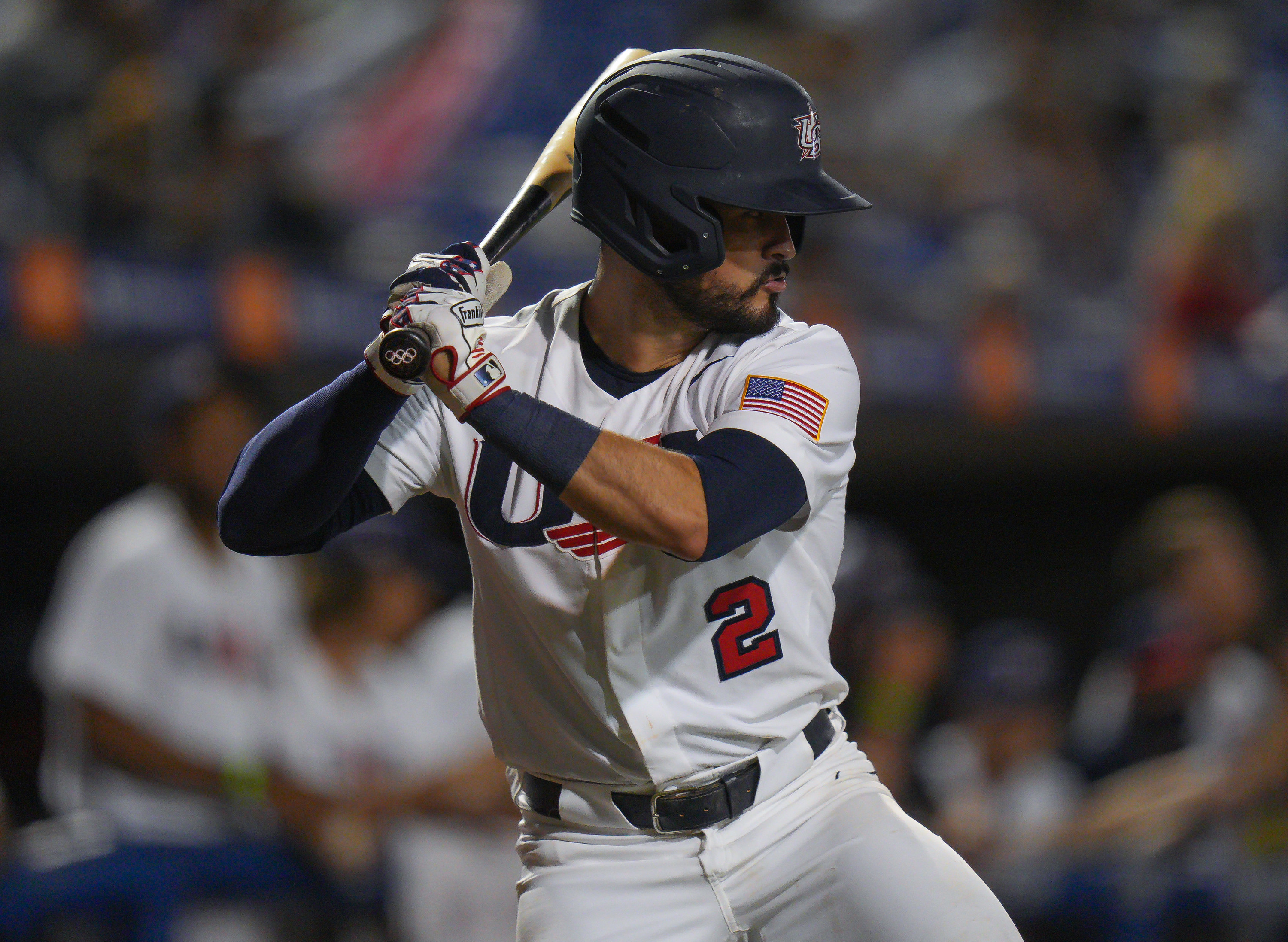 Baseball player holds a bat ready to swing