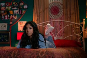 Still from the Netflix show Never Have I Ever of Devi laying on her bed looking bemused