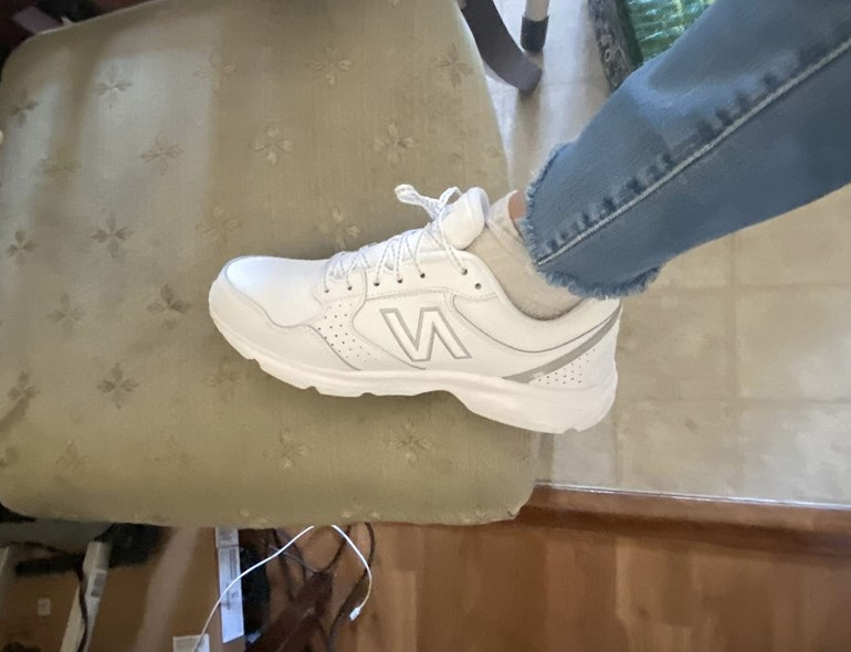 Reviewer photo of white New Balance sneaker worn with jeans