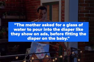 A guy drinking from a glass on a balcony while wearing a diaper