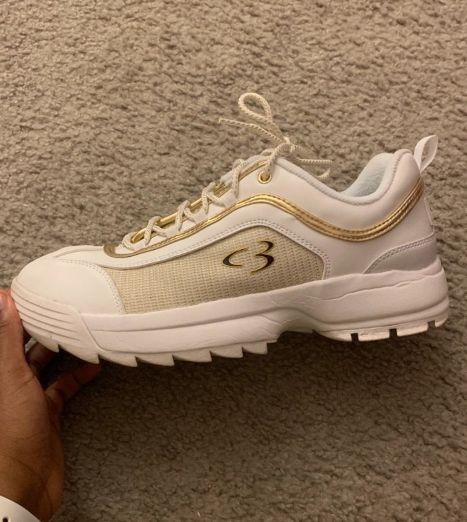 White sketchers with gold detailing