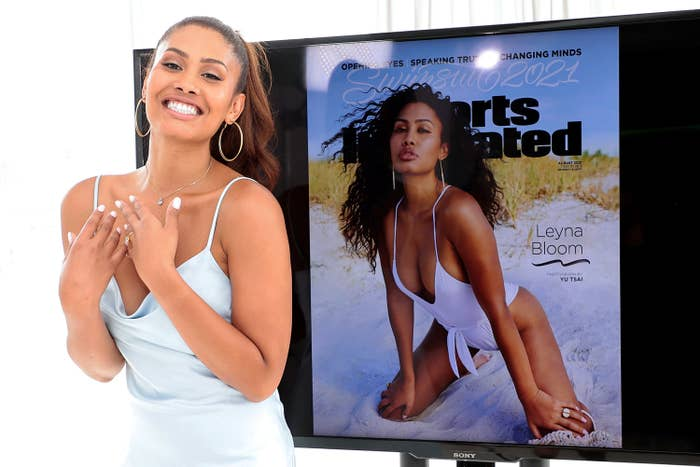 Leyna poses in front of a TV screen with her cover on it