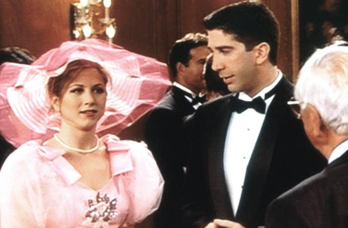 Screenshot of Rachel in a ugly pink bridesmaid dress